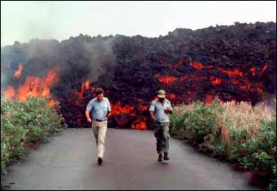 Scientists run from surging lava flow